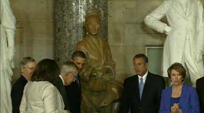 "WASHINGTON — Lawmakers unveiled Tuesday a statue of civil rights legend Rosa Parks that will stand in National Statuary Hall. Rosa Parks is famous for refusing to give up her seat to a white man on an Alabama public bus in 1955. She died in 2005 and became the first woman to lie in state in the U.S. Capitol rotunda. ""We celebrate a seamstress slight in stature but mighty in courage,"" President Barack Obama said. ""She defied the odds. She defied injustice. In a single moment, with the simplest of gestures, she helped change America and change the world."" Obama was joined by House Speaker John Boehner, Senate Majority Leader Harry Reid, members of the Parks family and other top officials. ""May this statue long be at tribute to her strength and spirit, her legacy and her leadership,"" House Minority Leader Nancy Pelosi said.  Rep. Jim Clyburn, D-S.C., a civil rights leader, said the rights Parks fought for could be rolled back, referring to the Supreme Court case being heard today that could invalidate parts of the Voting Rights Act. Parks was a symbol of the civil rights movement that reached its climax in the 1960s, when she collaborated with the NAACP and other famous figures like Martin Luther King Jr. —Marshall Cohen"