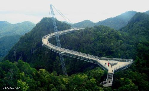earth-phenomenon:  The Langkawi sky-bridge in Malaysia is suspended at 700 metres above sea level and spans 125m across the mountains, offering magnificent views of the Andaman Sea and Thailand's Tarutao Island  Seems legit.