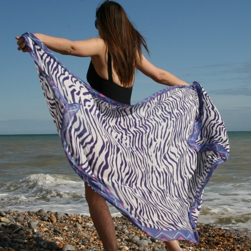 Gorgeously soft Animal Print Pareo in Linen rich fabric, soft & flowing, easy to tie in any way you like. Tie around neck for a draped look dress, across the bust and then tie underneath for smoother lines or just wrap it around your waist at any length you prefer! Echo: US design since 1923. SwimHut: fabulous swimwear all year round http://www.swimhut.com/product_info.php?cPath=5_6_13&products_id=961