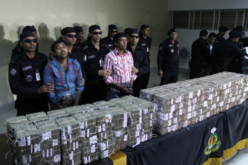 If only they could learn how corrupt politicians, bureaucrats and unethical businessmen loot more than that and know how to hang on to it.   Hollywood-Style Bank Heist in Bangladesh Ends in Arrest