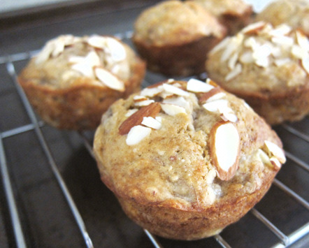 Banana Almond Muffins Ingredients: 4 very ripe bananas 1 egg, beaten 1 1/2 tbsp of greek yogurt 1/4 cup melted butter 1 tbsp whiskey (optional) 1 tsp vanilla extract 3/4 cup of light brown sugar, lightly packed 1 tsp baking soda 1 tsp salt 3/4 cup all-purpose flour 3/4 cup almond meal 1/4 cup almond slivers (optional) Directions: 1. Preheat oven to 350 degrees and prepare the muffin pan. 2. In a large bowl, mash the ripe bananas, leaving it chunky. Add the egg and yogurt and whisk to blend. 3. Next, add the melted butter, whiskey, and vanilla extract and whisk to blend. Then add the sugar, baking soda, and salt, and whisk until incorporated. 4. Sift in the flour and add the almond meal. Gently fold batter together. Do not over mix. 5. Fill muffin pan cups with batter 3/4 full and top with almond slivers. 6. Bake on middle rack for 18-20 minutes or until muffins spring back when gently pressed. 7. Rotate pan half way through baking. Let cool on a wire rack for 5 minutes. Enjoy!