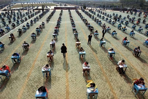 Exams in China..Exams in China are sometimes taken outdoors so that students can't cheat.
