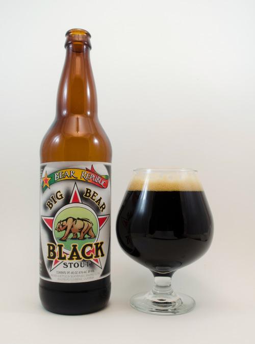 """Bear Republic """"Big Bear Black""""  90A-     This Double Stout is an old favorite of mine. Before I begin, I have to mention this awful label art. They seriously need to redesign their identity! This goofy, amateur look diminishes the concept of quality. Anyhow…the nose is weighed down by heavy aromas of roasted malt that  come across like unsweetened dark chocolate, coffee, caramel, and maybe a touch of vanilla. Like sour milk, hops add a faint hint of citrus with musty overtones.   As the palate opens, malts unfold a dense layer of dark chocolate. Sweetness develops a sort of caramel, brown sugar character, then the roast digs into a flavor reminiscent of burnt coffee beans. A moderate bitterness is propelled toward cocoa powder, then malts give way to some bready qualities. The finish is delineated by a sharp splash of hops, carrying flavors of orange peel and pine. The mouthfeel starts out very smooth, then departs dry and thirsty. Alcohol keeps to a modest 8.1%, so there's minimal flavor interference.   Overall, I think this is fairly hoppy in terms of style, so I consider it a West Coast interpretation. The roasted bitterness looms over sweetness with a modest 55 IBU's, which really isn't much, but carries just enough weight to dominate. Looking back at my review from one year ago, it's clear my palate has shifted, because I prefer less hoppy aggression from a Double Stout. Perhaps the concept of balance is subjective? Anyhow, it's a solid brew that hits the spot. I recommend it.  Hops: Centennial, Cascade8.1% 55 IBU Healdsburg, California"""