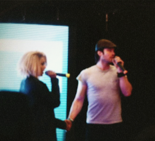 Kat and Ian holding hands at the convention in Paris (x)