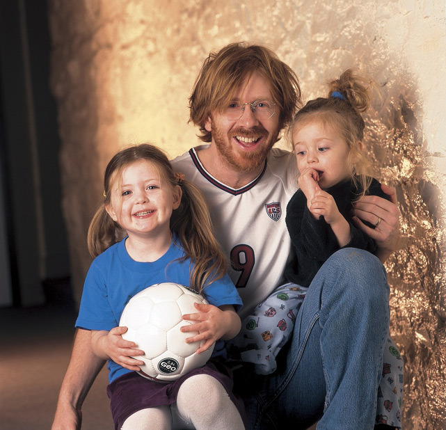 Phish lead singer Trey Anastasio sports a Mia Hamm jersey during a 1999 SI photo shoot with daughters Eliza and Isabella. (Damian Strohmeyer/SI) SI VAULT: Phish singer gets into World Cup spirit (12.20.99)