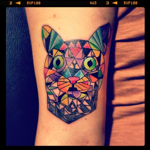 fuckyeahtattoos:  My asymmetric cat portre. Muse.Done in Turkey, Ankara by a marvelous tattoo artist working at home