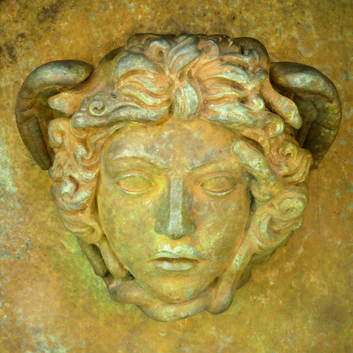 Medusa on bronze sculpture Ikaro caduto from Igor Mitoraj in the valley of the temples in Agrigento in Sicily. Photo May 2012 © Werner Schauer
