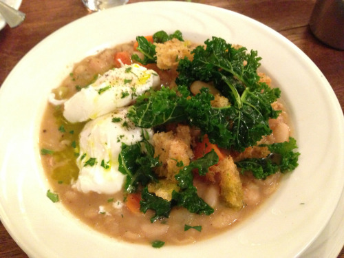Ribollita two poached eggs served over cannellini beans tuscan kale, parmesan broth, rosemary croutons. - Goat Town, NYC. #delicious!