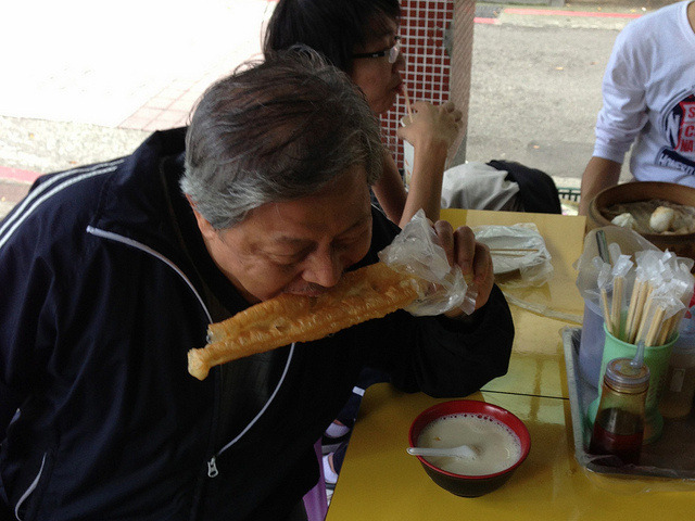 "Taipei Carbs – by Tao Lin above: Tao's dad eating an ""oil stick"" (literal translation from Mandarin)  Over the next month, in celebration of the forthcoming release of Tao Lin's latest novel, Taipei, we will be featuring a weekly selection of photos taken by the author during his recent trip to Taipei, Taiwan. While there, he took thousands of pictures with his iPhone, pictures which he has divided into albums titled things like ""Taipei fashion,"" ""Taipei food,"" ""Taipei babies,"" and ""Taipei animals,"" among others. The images were taken between January and February 2013 during one of his semiannual visits to the Taiwanese capital, where his parents live. This selection is titled ""Taipei Carbs."" All photos and captions by Tao Lin.Taipei will be released on June 4 from Vintage and is available for pre-order now. To read an early excerpt from the novel that we published in 2011 titled ""Relationship Story,"" click here. I seem to rush, whenever I see this photo, to think Huffington Post quickly, like I'm answering a question before someone else does Al Gore should abruptly stumble cross-stage during a TED talk, falling to his knees, when his vision is replaced with this photo, which he's never seen, for 2.5 seconds Continue"