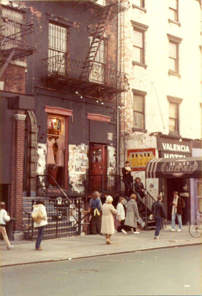 This is Saint Marks Place as it looked, also in November 1982. The shop with the dresses hanging up in the window is Trash and Vaudeville, which is famous for supplying stars like The Ramones and Debbie Harry of Blondie with clothing during the golden age of punk rock in the 1970s and 80s. The store opened in 1975 and is still in its original location. Next door is the Valencia Hotel which was home to beat writer William S. Burroughs in the early 1970s. In the 1980s punk rock singer-songwriter GG Allin lived there. The hotel is now the St. Mark's Hotel.