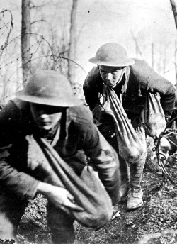 Soldiers advance into no-man's land with sacks of hand grenades. France, 1918. NY Times