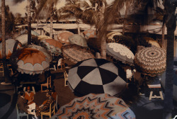 natgeofound:  Club members on the ocean front are shaded by decorative parasols, 1930.Photograph by Clifton R. Adams, National Geographic