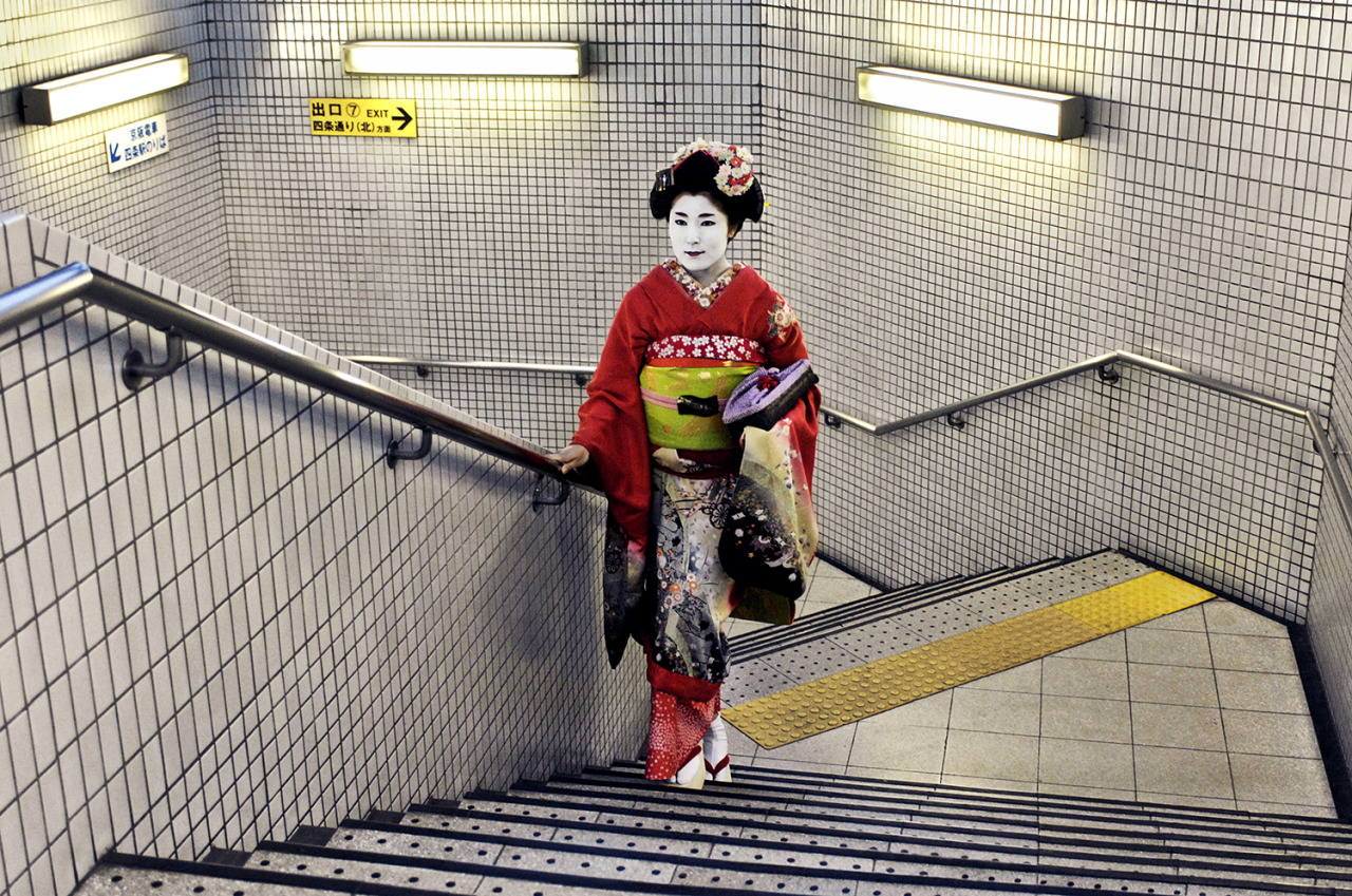 "Steve McCurry, ""Geisha in subway"" (2007), Kyoto, Japan This picture reflects the juxtaposition of an ancient tradition in the modern world. The woman is the epitome of elegance in a utilitarian, stark, unromantic setting. It captures the paradox of the classic in a hurried world. Earlier this month, Photo Booth looked at the New York City subway over time. This week, they've curated a selection of contemporary images from subways around the world. Click-through for a slideshow: http://nyr.kr/10JfLhy  (via newyorker:)"