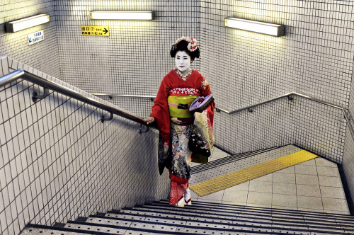 "Steve McCurry, ""Geisha in subway"" (2007), Kyoto, JapanThis picture reflects the juxtaposition of an ancient tradition in the modern world. The woman is the epitome of elegance in a utilitarian, stark, unromantic setting. It captures the paradox of the classic in a hurried world.  Earlier this month, Photo Booth looked at the New York City subway over time. This week, they've curated a selection of contemporary images from subways around the world. Click-through for a slideshow: http://nyr.kr/10JfLhy"