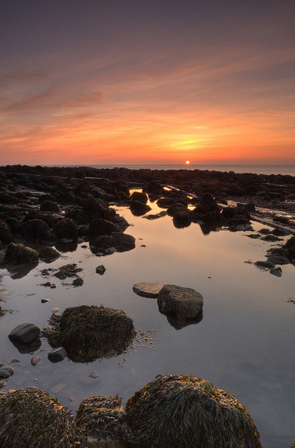 lvndscvpes:  Sunrise on the rocks. by paul downing on Flickr.