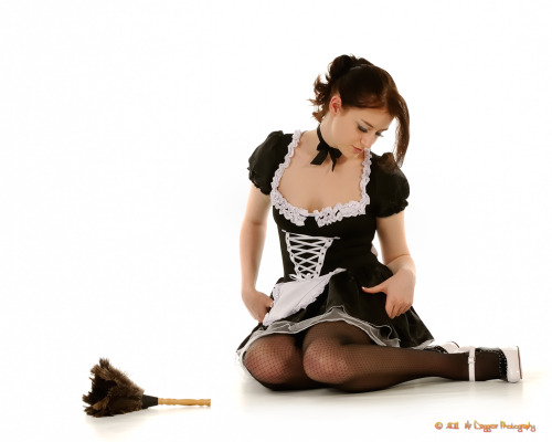 Pretty maid -having a hard time with her new heels - or just caught up admiring them?