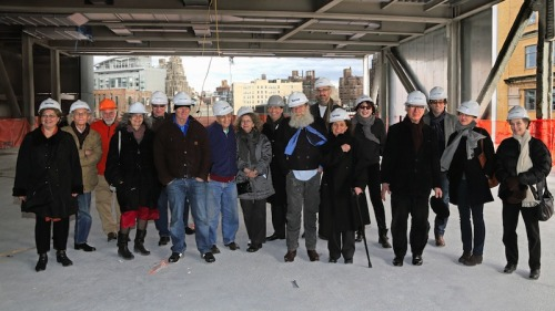 Artists tour the Whitney's new building site in downtown Manhattan, which will open in 2015.  From left to right: Whitney chief curator and deputy director for programs Donna De Salvo, Christo, Mark di Suvero, Hendel Teicher, Terry Winters, Jim Hodges, Frank Stella, Barbara Kruger, director Adam D. Weinberg, Lawrence Weiner, curator Carter Foster, Pat Steir, Marilyn Minter, Joost Elffers, T.J. Wilcox, Lauren Wolchik, and Harriet Stella.