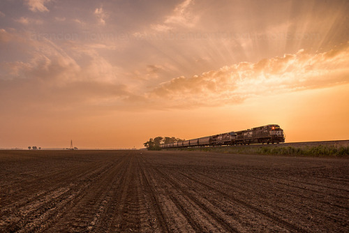 conrailbrian:  Morning Grain Train by Brandon Townley - www.brandontproductions.com on Flickr.