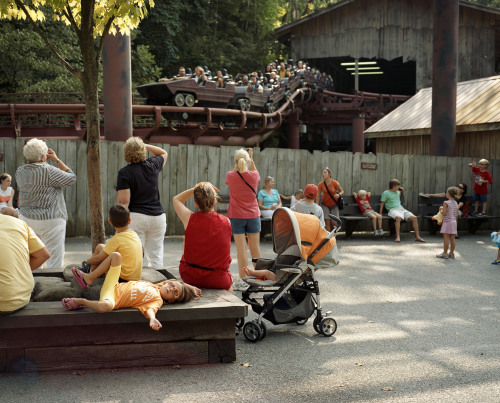 "DOLLYWOOD - TENNESSEE   ""A few years back, when I first started seeing the Hollywood sign, I kept thinking how cute it would be if I could change the H to a D—and see how long it would take anybody to notice. It just popped into my mind that it would be a good name for a park."" - Dolly Parton  Dolly Parton was born in Sevierville — pronounced SEVERE-ville — Tennessee, to a poor but loving family that included her parents and eleven siblings. It's tough to pick favorites by a woman who's written over 3,000 songs, but for a sampling of her best, I recommend the heartbreaking ""Jolene"", ""Coat of Many Colors"" — a classic about her early days — and ""I Will Always Love You"" (written by Dolly, but you might know Whitney Houston's 1992 version better). Dolly stayed true to her Tennessee roots and currently lives in Brentwood, right outside of Nashville. The Nashville bus tours that traverse the city — driving by famous country singers' homes — often get a big wave from the lady herself when she's in residence. In 1986, she co-opened Dollywood, a reincarnation of a lineage of theme parks like Rebel Railroad and Goldrush Junction. Today, Dollywood plays host to over 2.5 million guests a year and is the biggest employer in the Pigeon Forge area. The park truly embodies her spirit. Guests are welcomed by a kind tram driver who makes jokes and reminds them that they are parked in lot D/E for ""Dolly's Earrings."" Surrounded by beautiful foliage, the park is nestled at the bottom of the Great Smoky Mountains, which shade it all summer long. It has something for everyone: thrilling rides, country cooking, musical shows and tours through Dolly's childhood home (not to mention her tour bus when it's not on the road). Music floats in the air from the outdoor venues and the steam train whistle harmonizes from time to time. Guide Note: Come May time every year, see Dolly in person at ""Dolly's Homecoming Parade."" Friday, May 10th, will be the 28th annual, and will see Dolly borne by float along the streets of Pigeon Forge with marching bands, baton twirlers, horses, a submarine and a NASCAR race car.    Just outside of Pigeon Forge, be sure to stop in Sevierville's town square to see the bronze Dolly statue and, as is the local tradition, rub her boob for good luck.  * * * Tammy Mercure is a State Guide to Tennessee. She was recently named one of the ""100 under 100: The New Superstars of Southern Art"" by Oxford American magazine.  Follow on Tumblr at tammymercure or on her website, TammyMercure.com. Support her work at TCB Press."