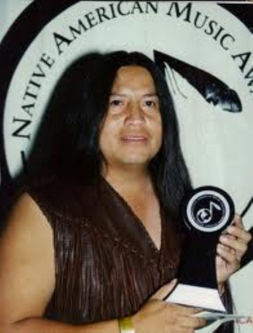 "Tommy Wildcat – Cherokee/Creek/Natchez Tommy Wildcat Tommy Wildcat (born May 3, 1967) is a Native American Cultural Promoter, flutist, historical storyteller, lecturer, and traditionalist. He is a fullblood Native American of Cherokee ancestry. Aniyvwiyv Jalagi ""Citizen of the Cherokee Nation"" ""Indian Territory"" Tahlequah, Oklahoma, he was born at the Old Hasting Indian Hospital by Northeastern State University in Tahlequah Oklahoma."