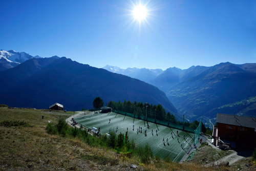 "afootballreport:  Europe's highest football pitch While the beautiful game may be found at higher altitudes in Bolivia, there's something special about this uncovered gem in Gspon, Switzerland. Set in the heart of the Swiss alps, ""Ottmar Hitzfeld stadium is carved into a mountainside 2,000 meters (6,561 feet) above sea level… The field, surrounded by vertiginous peaks near the resort of Zermatt, was built on one of the few patches flat enough to hold it. There wasn't enough room for a proper pitch, so the team plays on a three-quarter-size field akin to a five-a-side field. The turf is artificial, because grass won't grow at this altitude. And because the village is too high for traffic, players arrive by cable car."" Right, so how do we exchange our team bus for a team cable car?  [Full Wired article by Jeremy Hart]"