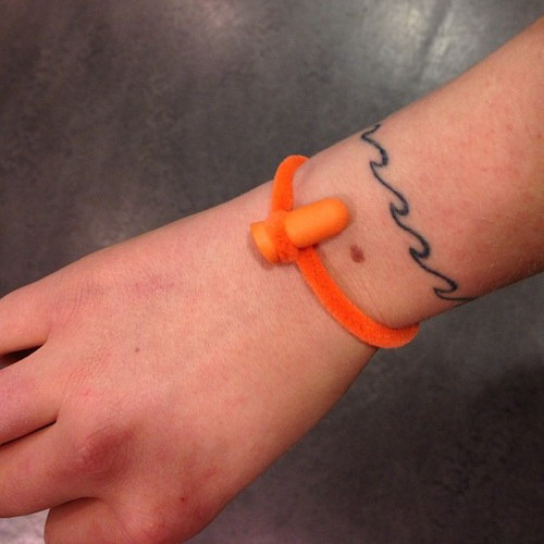 0001yes:  #bracelet made out of a pipe cleaner and an earplug by Frieda-raye Green on Flickr.
