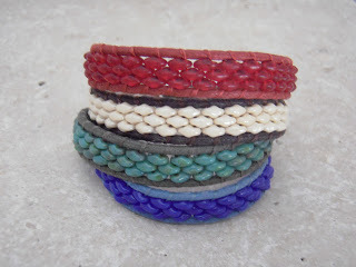 Anabe used twin beads and leather cord for these bracelets.