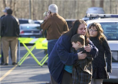 We're covering this terrible school shooting over on the website. Go here for the latest. [photo: REUTERS/ Michelle McLoughlin]
