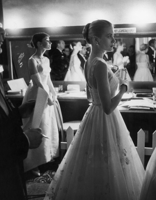 life:  Presenters Audrey Hepburn and Grace Kelly wait backstage at the RKO Pantages Theatre during the 1956 Academy Awards. See more photos here. (Allan Grant—Time & Life Pictures)