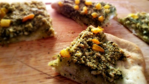 reblogged from livekindly:  Almond Pesto Pizza Recipe from Vegan Cooking for Carnivores This pizza was amazing! I recommend this cookbook to anyone especially new vegans. The author is Roberto Martin who is the chef for Ellen DeGeneres and Portia de Rossi. Many of the recipes are vegan-versions of comfort foods that most of us grew up with! For the Pesto: 2 oz. fresh basil leaves 3/4 cup slivered almonds 4 cloves garlic (I did not use that much because I am not a huge garlic fan) 2 tbs nutritional yeast or vegan parmesan 3/4 cup extra virgin olive oil 1/2 tsp. salt, plus more to season pepper Add first 6 ingredients to food processor and process until smooth. Season with salt and pepper. How much easier can it get?! At this point you can refrigerate it and use it as a dip or whatever you want. I spread mine on flatbread with yellow peppers on top and baked it for 10-15 minutes. In the book he recommended putting some grilled onions, zuchini and red peppers on it too which would taste awesome.