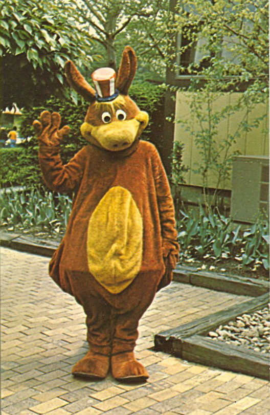 KENNY KANGAROO   KENNYWOODPittsburgh, Pa. The mascot, mayor and favorite muppet at Kennywood is Kenny Kangaroo. His antics delight the little tots and amuse the big folks.   Pathetic.