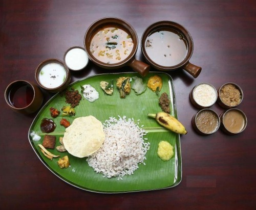 my-hindi-alma:  Sadhya is traditionally a vegetarian meal served on a banana leaf. People are seated cross-legged on the floor on a mat. All the dishes are served on the leaf and eaten with the hands without using any cutlery. The fingers are cupped to form a ladie. A Sadhya can have about 24-28 dishes served as a single course.