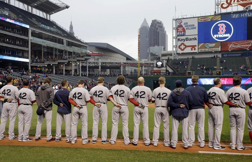 The Indians held a moment of silence with both teams along the base lines before the start of their game with the Red Sox on Tuesday. (Mark Duncan via The Boston Globe)
