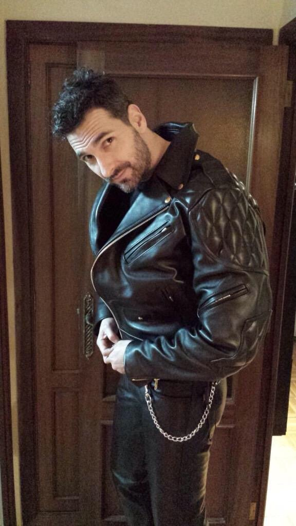 Gay men in leather biker gear