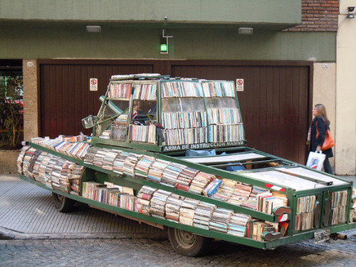 simonschusterca:  Weapon of Mass Instruction - The Argentinian Book Art Tank Raul Lemesoff coverted a 1979 green Ford Falcon into a moving library. The Ford falcon once belonged to the Argentinean armed forces during its dictatorship but is now covered with over 900 hardcover books. He travels cross-country handing out free literature.