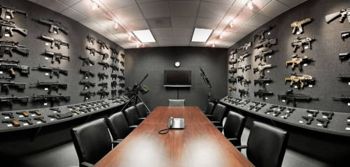 "tacticalneuralimplant:  The Heckler & Koch conference room (""The Grey Room"").  That row of XM8 series on the right wall~"