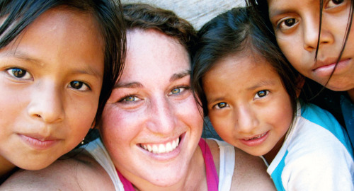 """I took this photo of myself with three second grade girls in a village in Guatemala, where my site mate and I worked with the community to build a three-classroom bottle school. These girls helped us collect bottles and fill them with trash. Someday I hope these girls will be able to attend school there."" - Peace Corps Health Volunteer Rebecca Dreyfuss"