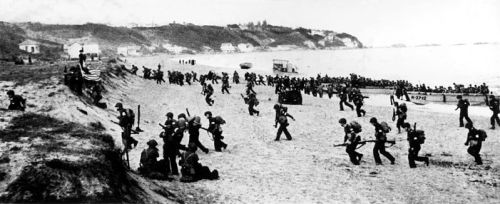 Allied troops hit the beaches near Algiers, behind a large American flagOperation Torch (initially called Operation Gymnast) was the British–American invasion of French North Africa in World War II during the North African Campaign, started on 8 November 1942.