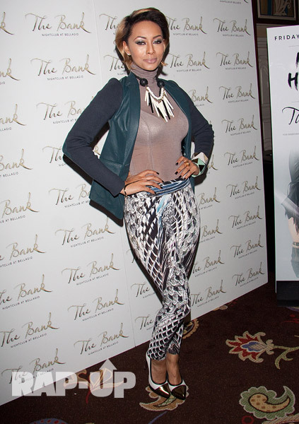 "Fresh from her trip to Thailand, Keri Hilson returned to the U.S. to host an evening at The Bank nightclub at The Bellagio in Las Vegas on Friday. The blonde bombshell was all smiles as she walked the carpet in a sheer turtleneck, leather jacket, and patterned leggings. ""I'm laughing all the way to @TheBankLV,"" she tweeted."