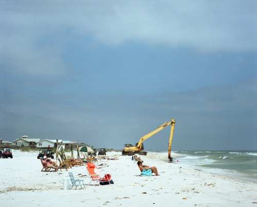 GULF SHORES, ALABAMA  The sandy soil becomes dazzlingly white near Fort Morgan; trees give way to grass and scrub palmettoes, and bay and gulf can be seen from the highway. — Alabama, A Guide to the Deep South (WPA, 1941)  On April, 20th 2010, the Deepwater Horizon drilling rig exploded, dumping some 4.9 million barrels of oil into the Gulf of Mexico over the span of a few months. Four hundred and ninety-one miles of coastline in Louisiana, Mississippi, Alabama and Florida were contaminated by oil. Clean up efforts used were not the most effective, nor the least toxic. Parts of the coast will never be the same. Part of my childhood. It's been two years since they capped the well. The beaches have opened, the resorts too. Regardless of what the BP-sponsored commercials are saying, it's not the same. The scar still runs deep. You walk down the beach and parts are closed from a fisherman finding tar balls washed up from the Gulf. A reminder of how things still need time and hope to change.  I spent all of my childhood in the Gulf and the surrounding bays. I was landlocked when the spill happened, but it still feels personal. * * *  Michael McCraw is a State Guide to Georgia and Alabama. He's a photographer who's spent his whole life in the South and when he's not photographing or writing you can find him with his family or stocking shelves at his work. Follow his work on Tumblr or at his website.