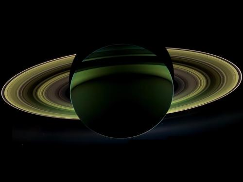 "science-junkie:  NASA's Cassini spacecraft has delivered a glorious view of Saturn, taken while the spacecraft was in Saturn's shadow. The cameras were turned toward Saturn and the sun so that the planet and rings are backlit. (The sun is behind the planet, which is shielding the cameras from direct sunlight.) In addition to the visual splendor, this special, very-high-phase viewing geometry lets scientists study ring and atmosphere phenomena not easily seen at a lower phase.  Since images like this can only be taken while the sun is behind the planet, this beautiful view is all the more precious for its rarity. The last time Cassini captured a view like this was in Sept. 2006, when it captured a mosaic processed to look like natural color, entitled ""In Saturn's Shadow."" In that mosaic, planet Earth put in a special appearance, making ""In Saturn's Shadow"" one of the most popular Cassini images to date. Earth does not appear in this mosaic as it is hidden behind the planet.  Also captured in this image are two of Saturn's moons: Enceladus and Tethys. Both appear on the left side of the planet, below the rings. Enceladus is closer to the rings; Tethys is below and to the left. (via NASA - A Splendor Seldom Seen)"