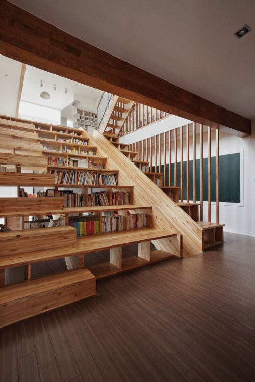 bookshelfporn:  A Library Slide We love this wooden slide that is slotted into a combined staircase and bookshelf of a house in Chungcheongbuk-do, South Korea, Designed by Moon Hoon. Submitted by Bookshelf Porn reader Jesse Richardson via Colossal.  Yes Please