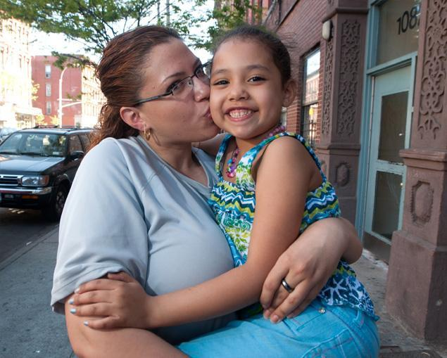 "Photo Caption: Bedford-Stuyvesant mom Eliana Luciano, 29, with her daughter Katherine, 6. Child Poverty Climbs To Nearly 50% In Gentrified Neighborhoods In NYC New York City neighborhoods attracting affluent new residents are also home to a more troubling trend - increasing child poverty. East Harlem and Bedford-Stuyvesant scored high on the Citizens' Committee for Children of New York's new ranking of the Big Apple's poorest communities. ""Pockets of extreme poverty persist in the city, even in neighborhoods that are often thought to be improving economically,"" said CCC executive director Jennifer March-Joly. Along strips like Bedford Ave. in Bedford-Stuyvesant and Lexington Ave. in East Harlem, wine bars, restaurants and chic boutiques have sprung up in recent years. But the neighborhoods also have pockets of growing poverty, CCC found.  Since the recession began in 2008, the numbers of children living in poverty in East Harlem jumped from 31.6 percent to 44.2 percent in 2010.  In Bedford Stuyvestant, where the white population jumped 600% since 2000, the number of kids living in poverty increased from 39.6 percent in 2008 to 47 percent. Median income for both neighborhoods was also surpringly low : Families with children under 18 in both East Harlem and Bedford Stuyvesant earned about $28,000 in 2010 - compared to the citywide average of about $61,000. ""You have young whites moving in,and minorities moving out. What is left behind are people who can't afford to move out,"" said CUNY graduate center sociologist Richard Alba. Single parent Eliana Luciano, 29, is about to lose her $1,070 one-bedroom apartment she shares with her daughter Katherine, 6 and elderly mom. ""I can't afford my rent,"" said Luciano who makes $7.60 an hour working at CVS. ""It's hard. You can't find a decent job."" Richard Toxe, a father of four who works as a nursing assistant, lives in Metro Plaza Houses on First Avenue in East Harlem, sandwiched between two new pricy luxury buildings with amenities like a shuttle bus and a white-gloved doorman.  ""These buildings affected everything,"" said Toxe complaining he has to travel uptown to buy milk and meat because his local Associated supermarket raised its prices."