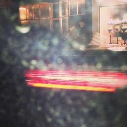 Accidental photo. Flash caught a car driving past.  (at Thomas Dux Grocer)