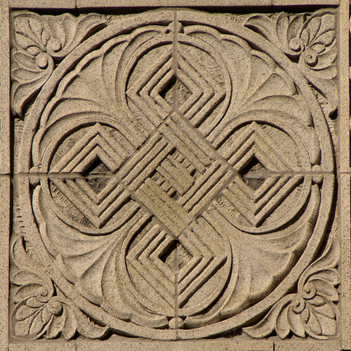 Exterior Detail, Chicago, Illinoisby Terence Faircloth Celtic knot. From Flickr:  Stylized terra cotta ornament on a building at the corner of Lake and Wabash in the downtown area of Chicago, Illinois.