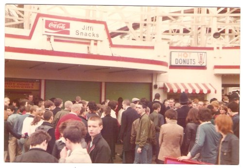 Skinheads in Dreamland, Margate circa 1980. This is 2-Tone era where the cult was big again. Note the policemen to the right of shot. Just about every skinhead coat of the era in shot here.