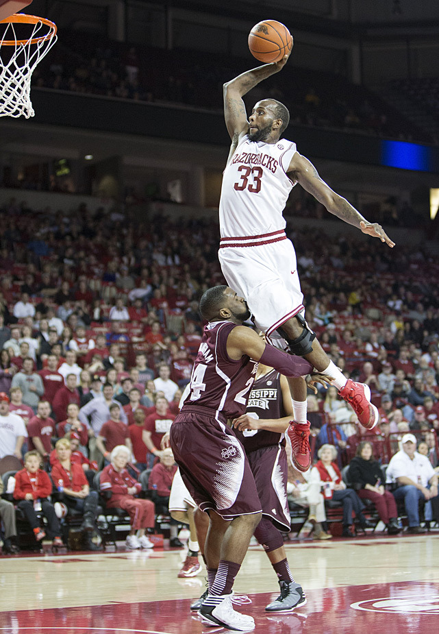 Arkansas' Marshawn Powell goes up for a dunk over Mississippi State's Trivante Bloodman  but is called for a charge during last night's game in Fayetteville. The Razorbacks defeated the Bulldogs 96-70. (Wesley Hitt/Getty Images) GLOCKNER: Recapping a wild Wednesday in college hoops