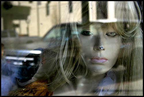 She had existential distractions Storefront reflection Photography by harry Snowden