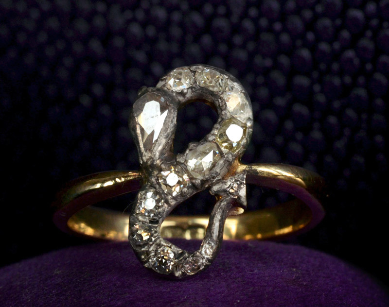 19th Century Diamond Serpent Ring, Modified Mine & Rose Cut Diamonds, Silver, 18K (sold) This wonderful and peculiar ring was in sad shape when I found it.  The diamond studded serpent is Georgian-era, but it had been badly mounted onto a turn-of-the-century English 18K shank.  And it had several missing and broken stones.  We fixed it up with period stones and rebuilt the mount to be more secure and tidier looking.  Since the shank is clearly not the same period, I'm not sure if the serpent was part of a ring originally.  But in any case it works well. That pear-shaped mine cut is a prize— pear shaped diamonds of this period are very rare.
