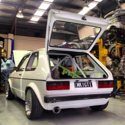 downshiftaus:  This little Mk1 Golf was my favorite car of the trip. An absolutely flawless build, everything about the car is done perfectly with nothing being overlooked. It is a very hush hush build so I cannot delve into the specs but this is one to watch!!! #volkswagen #vw #dublyf #mk1 #rabbit #golf #gti #white #cage #showspec #immaculate #flawless #bbs #rs #polished #onetowatch #actuallyinlove #euro #hothatch #downshiftaus